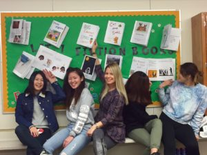 Ms. Neuscheler, along with her ELL students, display their Fiction books and menus they created to develop their vocabulary and use of English!