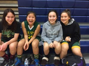 This photo was after a Junior Girls 32-31 win over Langley Fundamental; I guess Saints DO have fun, too!