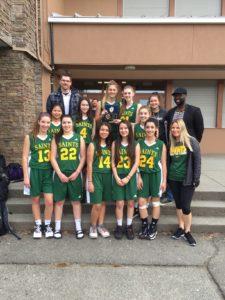 Mr. Sheppard, Mr. Powell, Ms. Neuscheler, and the 2nd place Junior Girls basketball team!