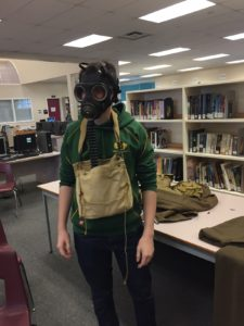 Another student tries on a gas mask!